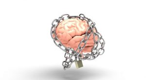 Brain covered in chains and lock to represent a person not understanding their emotions before counselling.