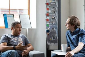A man speaking with his counsellor at mediation.